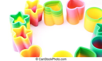 Many plastic toys-springs - many multicolored plastic...