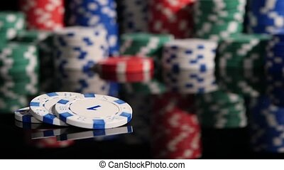 many poker chips falling on a black background. 2 pack. Slow motion