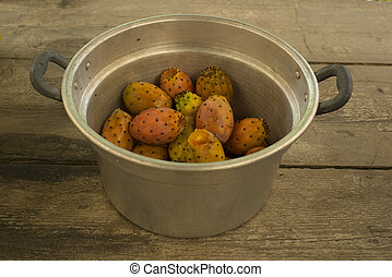 many prickly pears in a large aluminum pot.