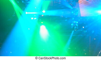 Many rave party, green light lazer beam lattice, view from...