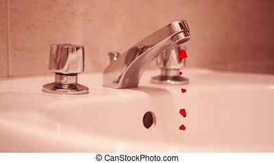 Many red hearts come out of the tap at home instead of water