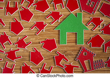 Many red house symbol on wooden background.