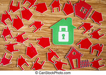 Many red house symbol on wooden background