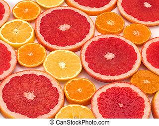Many ripe grapefruit. orange, lemon slices, closeup