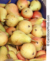 ripe pears in the box of greengrocer for sale