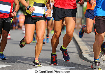 many runners with sneakers