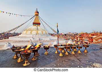 Many sacred candles in front of Boudha Nath (Bodhnath) stupa...