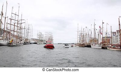 Many sailing boats stand on mooring in port of Stavanger
