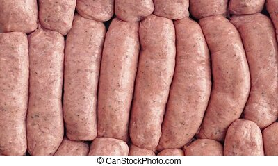 Many Sausages Rotating - Raw sausages turning slowly
