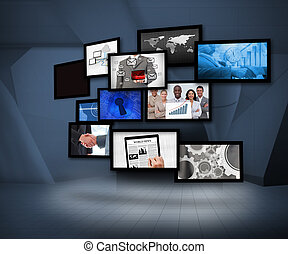 Many screens showing business images under a spotlight on...