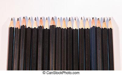 Sharp Black Pencils Isolated on White Background