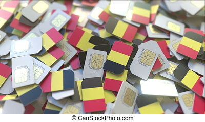 Pile of SIM cards with national flag. Mobile telecommunications related conceptual 3D