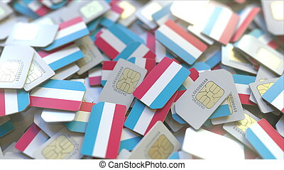 Many SIM cards with flag of Luxembourg. Luxembourgian mobile...
