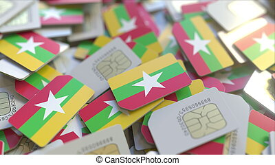 Many SIM cards with flag of Myanmar. Myanma mobile telecommunications related 3D rendering