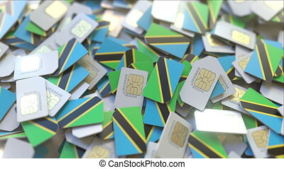 Many SIM cards with flag of Tanzania. Tanzanian mobile...