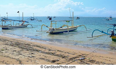 Many small boats tied and anchored off popular tourist beach...