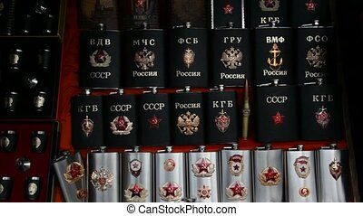 Many souvenir flasks with Soviet and Russian symbols in shop...