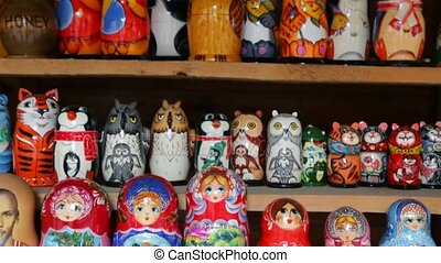 Many souvenir Russian wooden dolls, which are called Matryoshka and figures of temples