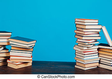 many stacks of educational books for exams at school in the library on a white background