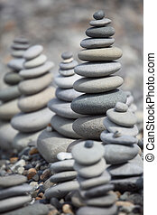 stone stacks on pebble beach - many stone stacks on pebble...