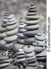 stone stacks on pebble beach - many stone stacks on pebble ...