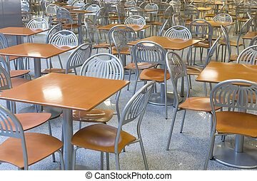 tables and chairs in the interior of the city cafe