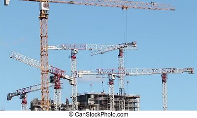 many tower cranes - construction with many high-rise cranes