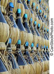many traditional chianti bottles as background, Florence, Tuscany, Italy