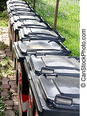 many trash bins for separate waste collection of municipal solid waste in the city 2