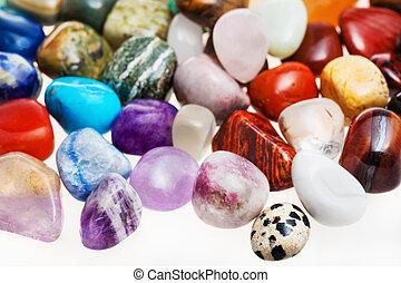 many tumbled natural mineral gem stones
