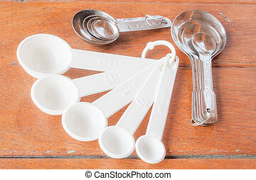 Many types of bakery  measuring spoons on wood table
