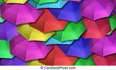 Many Brightly Colored Umbrellas overlapping each other for background