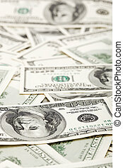 Many US 100 dollars, business background, shallow depth of field