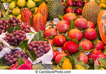Many various Fresh fruit at a market stall in Barcelona