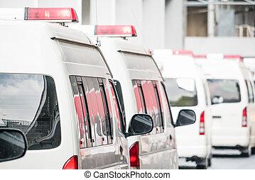 Many white ambulance cars on the road