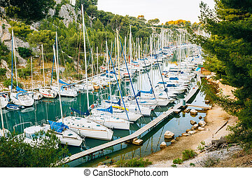Many White Yachts Boats Moored In Calanques Bay in France - ...