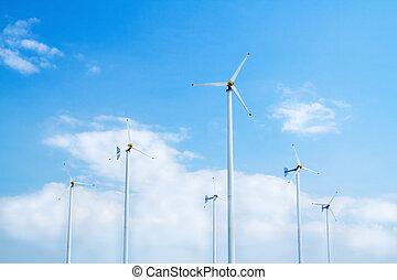 Many wind turbine generating electricity on blue sky
