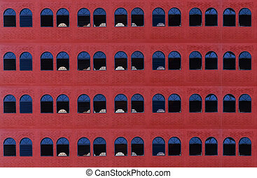 Many windows on old red brick wall, background
