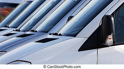 many windshields of delivering cars in a row