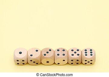 Many wooden dice