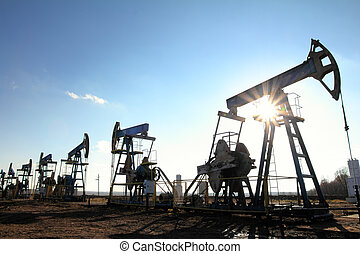working oil pumps silhouette in row