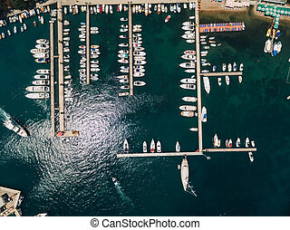Many yachts dock on the pier near the city of Budva Montenegro. View from above