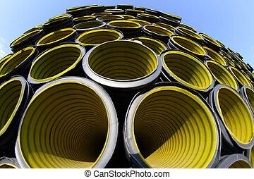 yellow corrugated tube photographed with fisheye lens - many...
