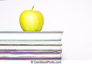 manzana, en, un, montón libros