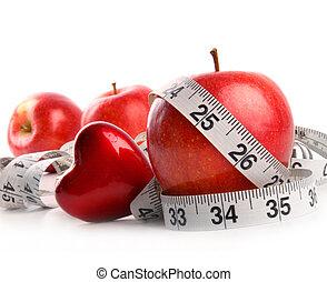 manzanas rojas, y, cinta medición, blanco