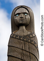 Maori Culture - Wood Carving - A wood carved figure of a...