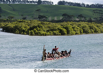 TAIPA, NZ - MAY 18:Maori War Waka on May 18 2013. Waka taua (war canoes) are large canoes manned by up to 80 paddlers and are up to 40 meters (130 ft) in length.