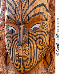 Maori Warrior Mask - An ancient carved wooden mask of a...