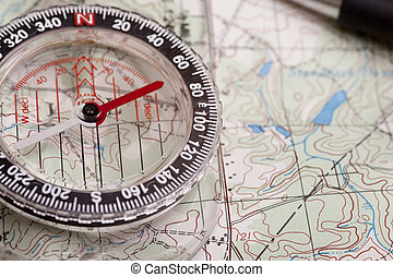 Map and compass - A compass on a topographical map showing...
