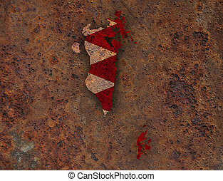 Map and flag of Bahrain on rusty metal